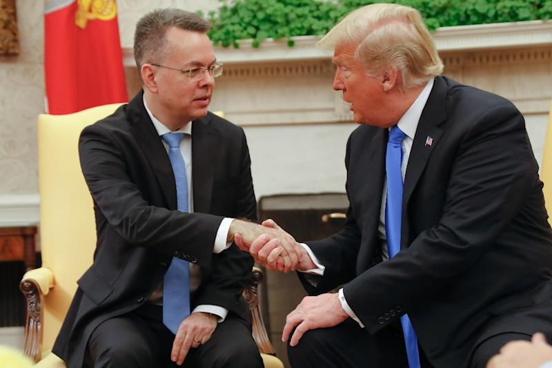Freed American pastor Andrew Brunson (L) shakes hands with US President Donald Trump at the White House (AFP Photo/ROBERTO SCHMIDT)
