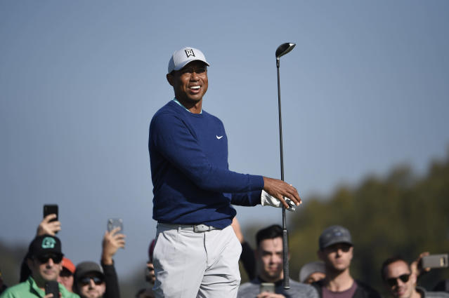 Tiger Woods watches the flight of his tee shot on the second hole of the South Course at Torrey Pines Golf Course during the third round of the Farmers Insurance golf tournament Saturday Jan. 25, 2020, in San Diego. (AP Photo/Denis Poroy)