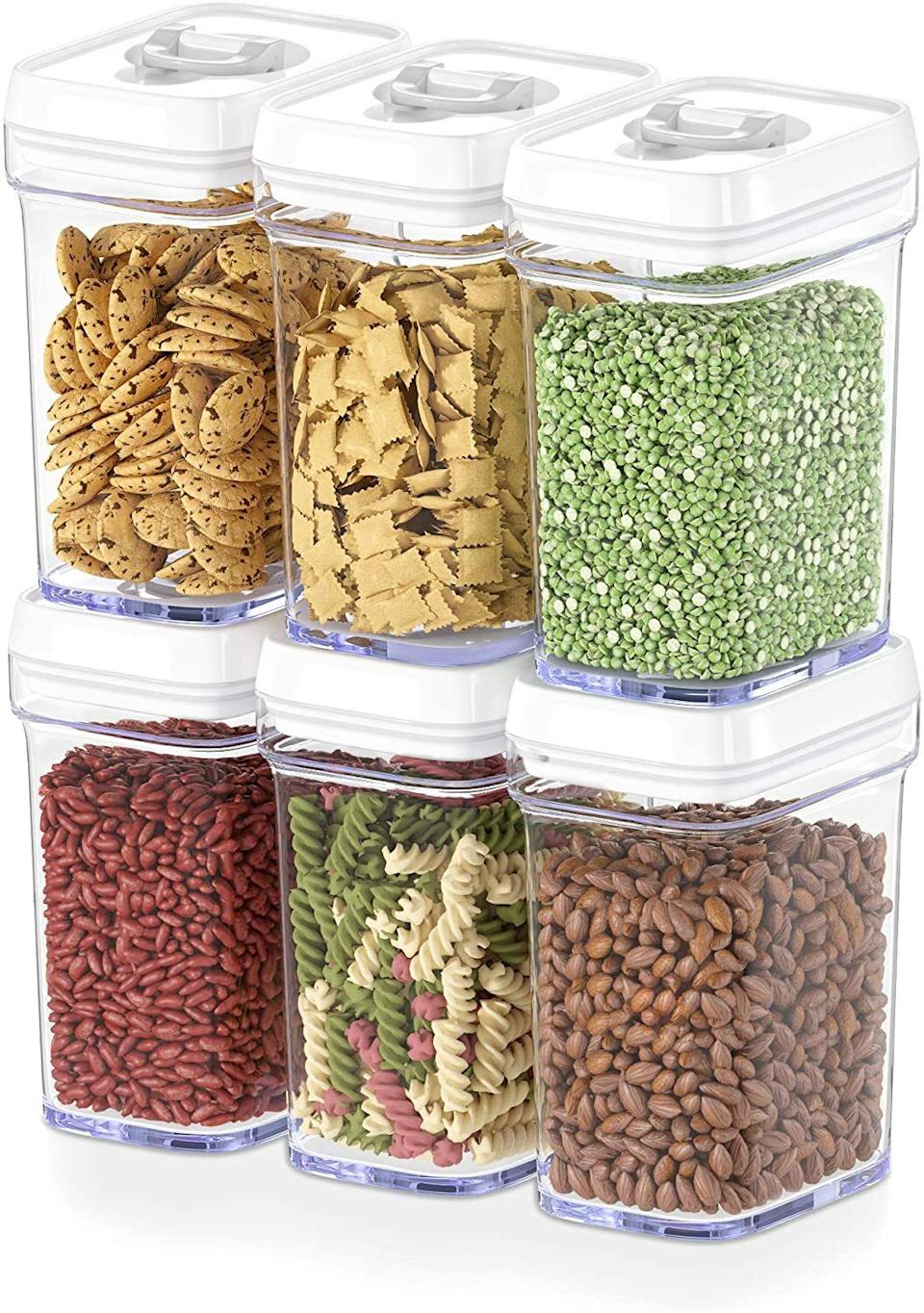 """Not only do these make finding and stacking your food a cinch, they will also keep your food fresher for longer. And if snacks are easy to find, """"hanger"""" stays at bay! That's science.<br /><br /><strong>Promising review:</strong>""""I got these to store my pup's treats for easy access and airtight storage. They're much cheaper than the<a href=""""https://amzn.to/3x9w8Gm"""" target=""""_blank"""" rel=""""nofollow noopener noreferrer"""" data-skimlinks-tracking=""""5902331"""" data-vars-affiliate=""""Amazon"""" data-vars-asin=""""B07T9919G6"""" data-vars-href=""""https://www.amazon.com/dp/B07T9919G6?tag=bfmal-20&ascsubtag=5902331%2C6%2C37%2Cmobile_web%2C0%2C0%2C16540701"""" data-vars-keywords=""""cleaning"""" data-vars-link-id=""""16540701"""" data-vars-price="""""""" data-vars-product-id=""""17905671"""" data-vars-product-img=""""https://m.media-amazon.com/images/I/51YlWRnyKyL.jpg"""" data-vars-product-title=""""New OXO Good Grips 8-Piece POP Container Baking Set"""" data-vars-retailers=""""Amazon"""">OXO pop containers</a>I love so much, but look just as pretty.<strong>They stack neatly and don't pop open if/when they fall but the lid is easy to open and close.</strong>Overall a good purchase, and I will likely get more in different sizes for my pantry."""" —<a href=""""https://amzn.to/3uLtHHY"""" target=""""_blank"""" rel=""""nofollow noopener noreferrer"""" data-skimlinks-tracking=""""5902331"""" data-vars-affiliate=""""Amazon"""" data-vars-href=""""https://www.amazon.com/gp/customer-reviews/R3PQ8ZVUHBR7QG?tag=bfmal-20&ascsubtag=5902331%2C6%2C37%2Cmobile_web%2C0%2C0%2C16540698"""" data-vars-keywords=""""cleaning"""" data-vars-link-id=""""16540698"""" data-vars-price="""""""" data-vars-product-id=""""20969630"""" data-vars-product-img="""""""" data-vars-product-title="""""""" data-vars-retailers=""""Amazon"""">V1r2g0<br /><br /></a><strong>Get a six-piece set from Amazon for<a href=""""https://amzn.to/3gkksKZ"""" target=""""_blank"""" rel=""""nofollow noopener noreferrer"""" data-skimlinks-tracking=""""5902331"""" data-vars-affiliate=""""Amazon"""" data-vars-asin=""""B07N7M4JVX"""" data-vars-href=""""https://www.amazon.com/dp/B07N7M4JVX?tag=bfmal-20&ascsubtag=5902331%"""