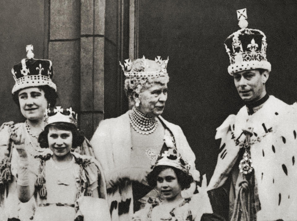 King George VI and his wife Queen Elizabeth seen here on the balcony at Buckingham Palace, London, England the day of their coronation, 12 May, 1937, with their daughters Princess Margaret and Princess Elizabeth, future Queen Elizabeth II and the king's mother Mary of Teck. George VI, 1895 – 1952, King of the United Kingdom. Elizabeth Angela Marguerite Bowes-Lyon, 1900 – 2002. Queen consort of the United Kingdom as the wife of King George VI. Princess Margaret, later Countess of Snowdon, 1930 – 2002. Princess Elizabeth, later Queen Elizabeth II, born 1926. Mary of Teck, 1867 – 1953. Queen consort of the United Kingdom and the British Dominions, and Empress consort of India, as the wife of King-Emperor George V. From The Coronation of King George VI and Queen Elizabeth, published 1937. (Photo by: Universal History Archive/Universal Images Group via Getty Images)
