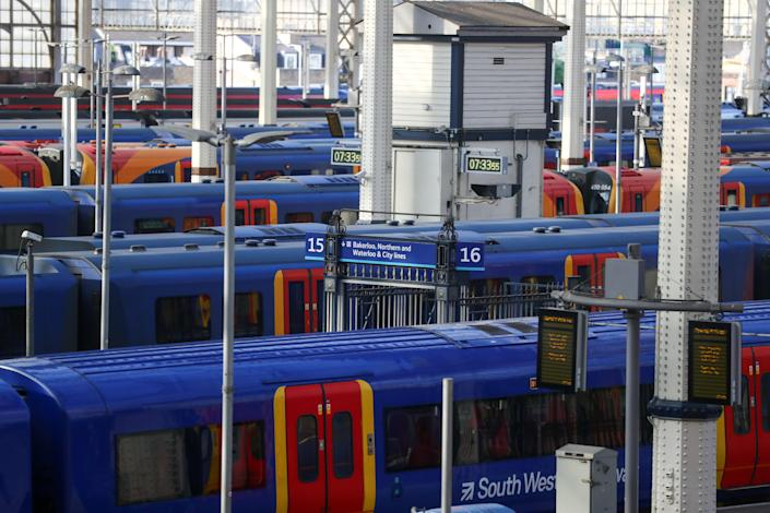 Railway trains, operated by South Western Railways run by the FirstGroup Plc and MTR Corp. Ltd. franchise, sit at platforms at London Waterloo railway station in London, U.K., on Thursday, May 21, 2020. Photo: Simon Dawson/Bloomberg