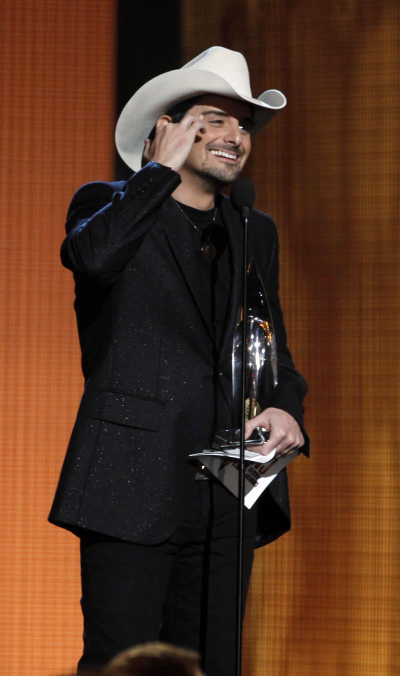 Brad Paisley accepts the Entertainer of the Year Award at the 43rd Annual Country Music Awards in Nashville, Tenn. Wednesday, Nov. 10, 2010. (AP Photo/Mark Humphrey)