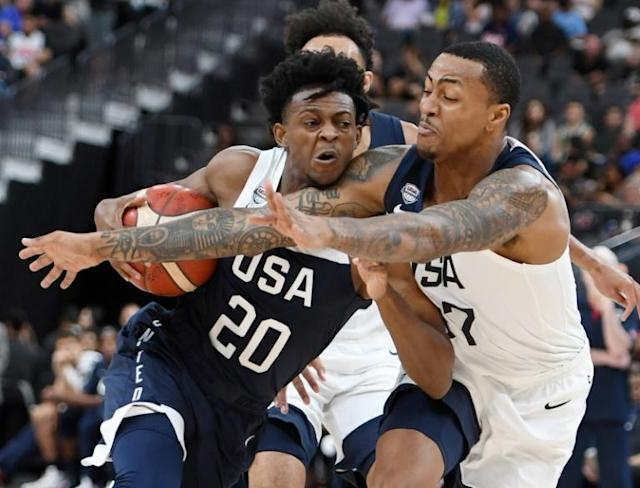Sacramento Kings guard De'Aaron Fox, driving to the hoop against John Collins, withdrew from the United States team for the Basketball World Cup on Saturday (AFP Photo/Ethan Miller)