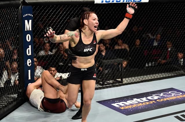 Cris Cyborg celebrates after her TKO victory over Yana Kunitskaya in their women's featherweight bout during the UFC 222 event inside T-Mobile Arena on March 3, 2018 in Las Vegas, Nevada. (Getty Images)