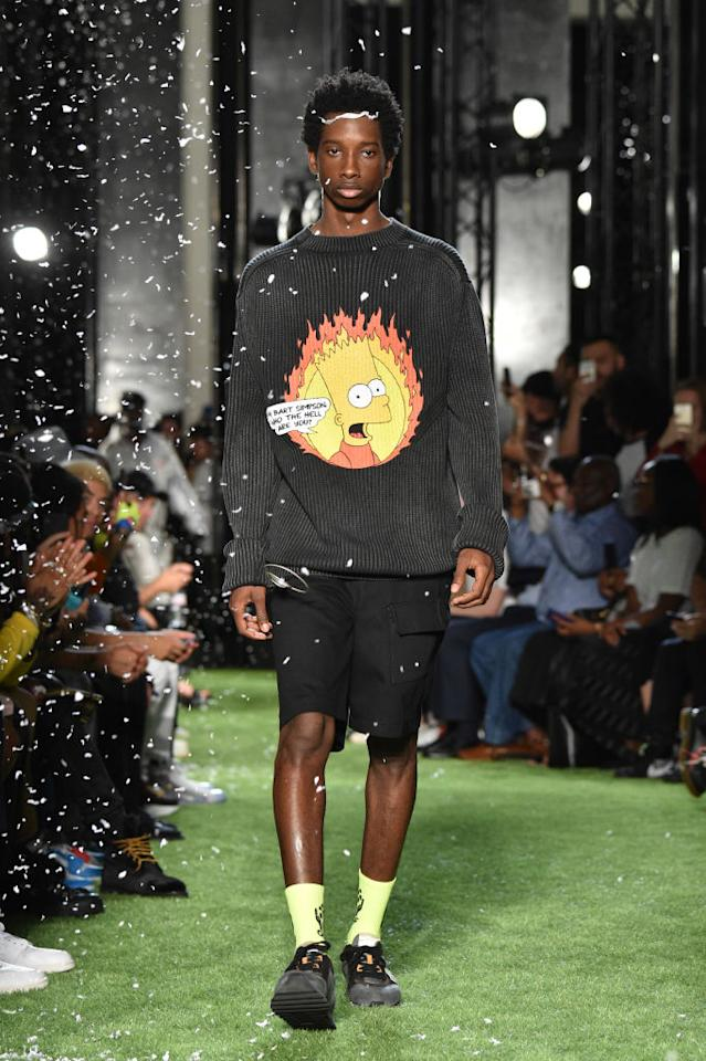 <p>Model wears black ribbed sweater with Bart Simpson graphic, paired with black shorts and sneakers, at the Spring 2019 Off-White men's show in Paris. (Photo: Getty Images) </p>