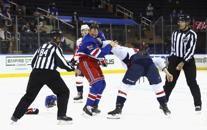 New York Rangers' Anthony Bitetto (22) and Washington Capitals' Michael Raffl (17) fight during the first period of an NHL hockey game Wednesday, May 5, 2021, in New York. (Bruce Bennett/Pool Photo via AP)