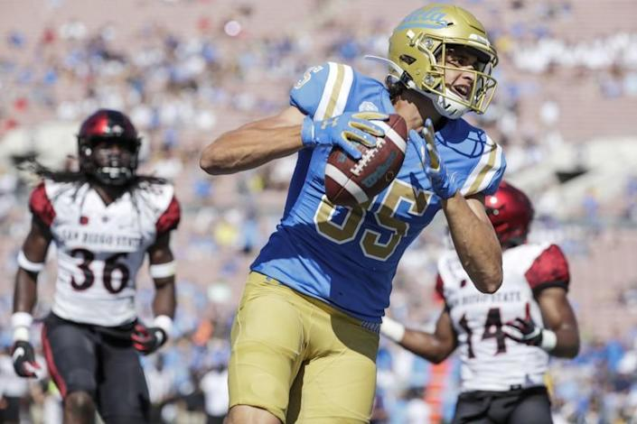 UCLA tight end Greg Dulcich scores a touchdown in the third quarter.