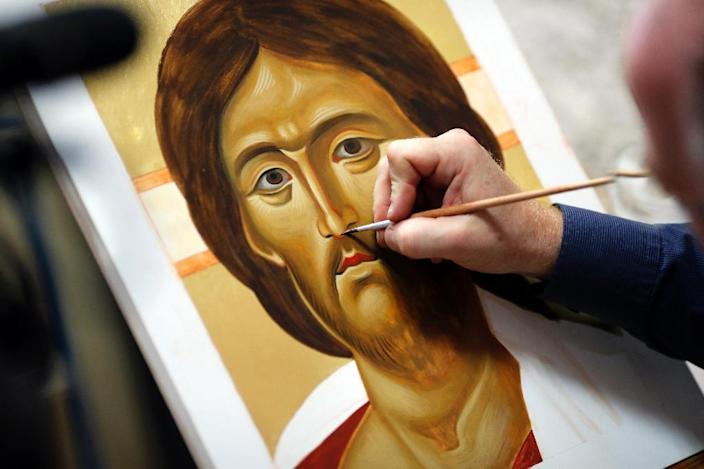 "For some students at Bethlehem Icon Center, the chance to paint Christ is ""a way of getting deeper into the story of the Bible"" (AFP Photo/THOMAS COEX)"