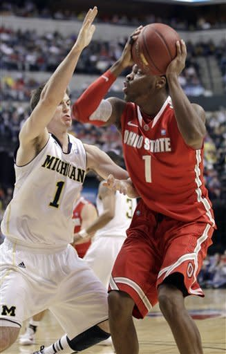 Ohio State forward Deshaun Thomas, right, drives against Michigan guard Stu Douglass in the first half of an NCAA college basketball game in the semifinals of the Big Ten Conference tournament in Indianapolis, Saturday, March 10, 2012. (AP Photo/Michael Conroy)