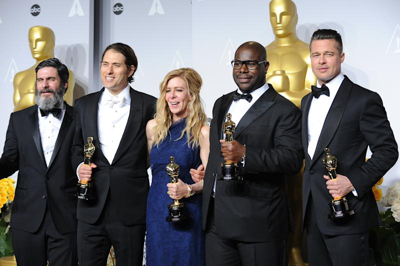 "(L-R) Producers Anthony Katagas, Jeremy Kleiner, Dede Gardner, director Steve McQueen and Brad Pitt, winners of Best Picture for ""12 Years a Slave"", pose in the press room at Loews Hollywood Hotel. (Photo by Frank Trapper/Corbis via Getty Images)"