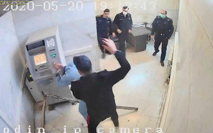 A grab from a leaked video showing a guard beating a prisoner in Evin prison in Tehran - The Justice of Ali via AP