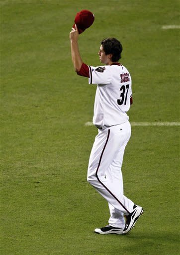 Arizona Diamondbacks pitcher Tyler Skaggs tips his cap after leaving the game during the seventh inning of a baseball game against the Miami Marlins, the first game of a doubleheader, Wednesday, Aug. 22, 2012, in Phoenix. It was Skagg's major league debut. (AP Photo/Matt York)