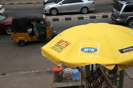 The logo of MTN telecommunication company is seen printed on a umbrella at a call point along a road in Lagos