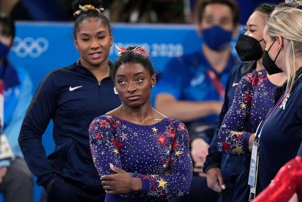 PHOTO: Simone Biles, of the United States, waits for her score after performing on the balance beam during the women's artistic gymnastic qualifications at the 2020 Summer Olympics, Sunday, July 25, 2021, in Tokyo. (Gregory Bull/AP Photo)