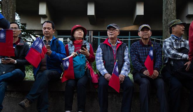 KMT supporters at a pre-election rally. Photo: Bloomberg