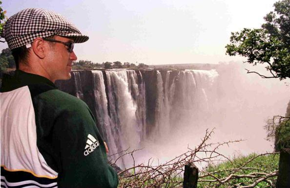12 Oct 1999:  Justin Langer of Australia looks over the Victoria Falls in Zimbabwe. Mandatory Credit: Hamish Blair/ALLSPORT