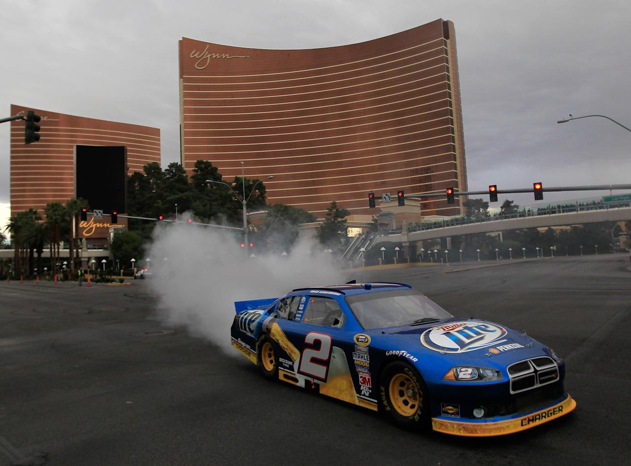 LAS VEGAS, NV - DECEMBER 01:  Brad Keselowski, driver of the #2 Miller Lite Dodge, does a burnout during the NASCAR Victory Lap in front of the Wynn Las Vegas on Las Vegas Boulevard on December 1, 2011 in Las Vegas, Nevada.  (Photo by Chris Trotman/Getty Images for NASCAR)