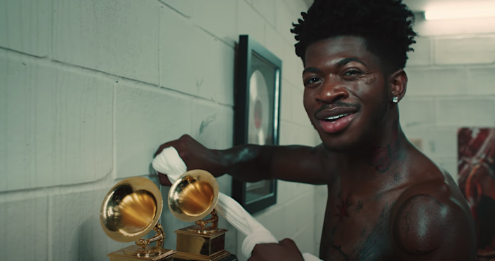 Lil Nas X cleaning two Grammys