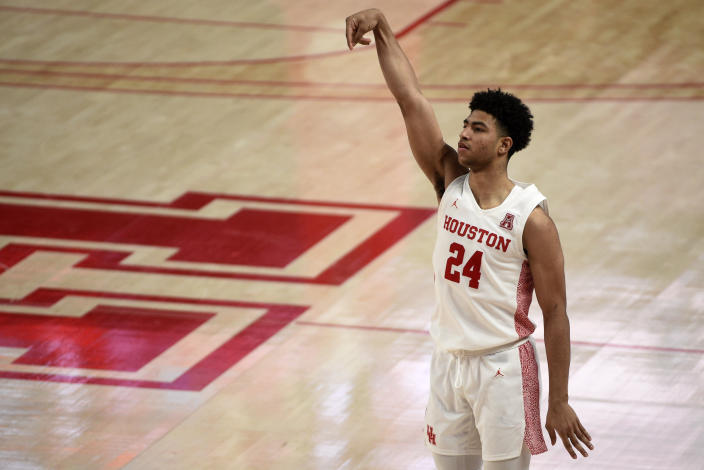 Houston guard Quentin Grimes (24) watches his 3-point basket during the second half of an NCAA college basketball game against Cincinnati, Sunday, Feb. 21, 2021, in Houston. (AP Photo/Eric Christian Smith)