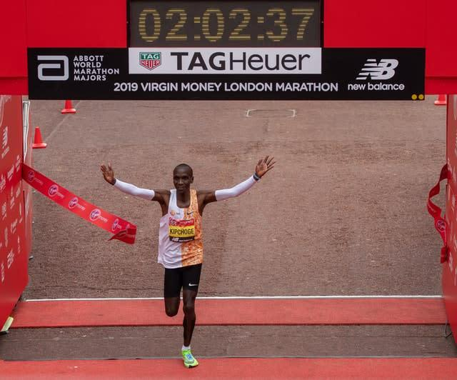 Eliud Kipchoge crosses the line to win the Elite Men's Race during the 2019 Virgin Money London Marathon (Andrew Baker Photography)