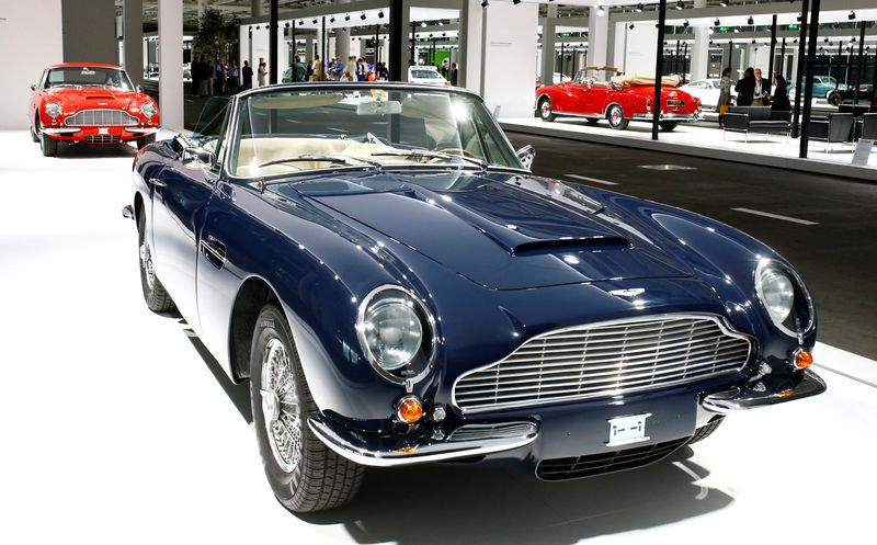 FILE PHOTO: Aston Martin DB6 Volante convertible sports car is displayed in front of a Aston Martin DB6 coupe during Grand Basel autoshow in Basel