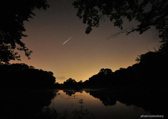 Stargazing photographer Jonathan S. McElvery captured this view of a Perseid meteor over Grafton, Mass., early on Aug. 12, 2013 during the peak of the 2013 Perseid meteor shower. He used a Nikon D700 camera equipped with a 14mm lens and set to