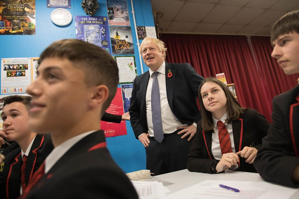 Prime Minister Boris Johnson joins pupils during a visit to George Spencer Academy in Nottingham, while on the General Election campaign trail around the country.