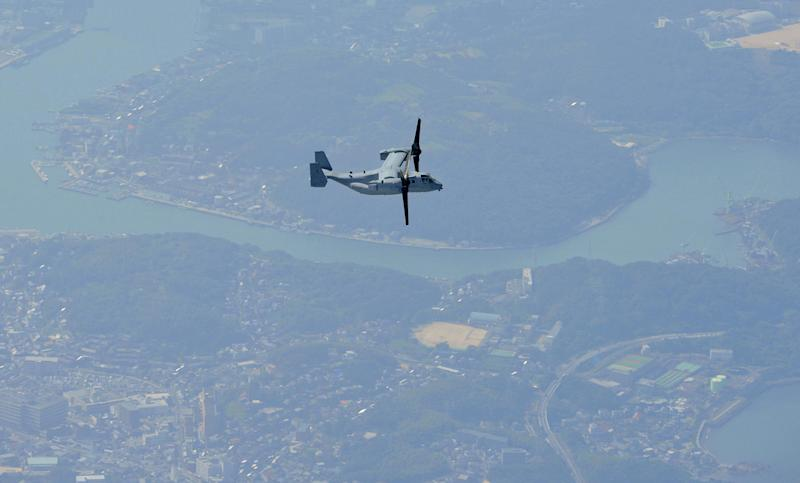 The MV-22 Osprey aircraft flies over Shimonoseki city, Yamaguchi prefecture, southern Japan Friday, Sept. 21, 2012. The U.S. Marines are conducting their first test flights of the MV-22 Osprey aircraft in Japan after months of protests there over safety concerns. (AP Photo/Kyodo News) JAPAN OUT, MANDATORY CREDIT, NO LICENSING IN CHINA, HONG KONG, JAPAN, SOUTH KOREA AND FRANCE
