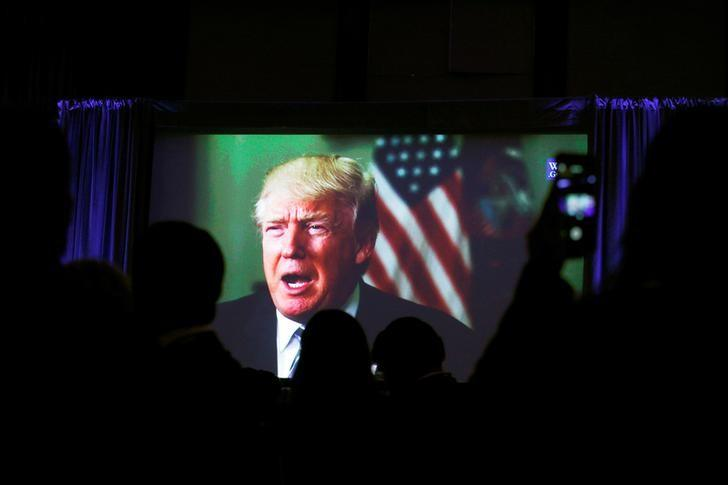 Guests watch a video of Trump as he addresses the 15th Plenary Assembly of the World Jewish Congress in New York
