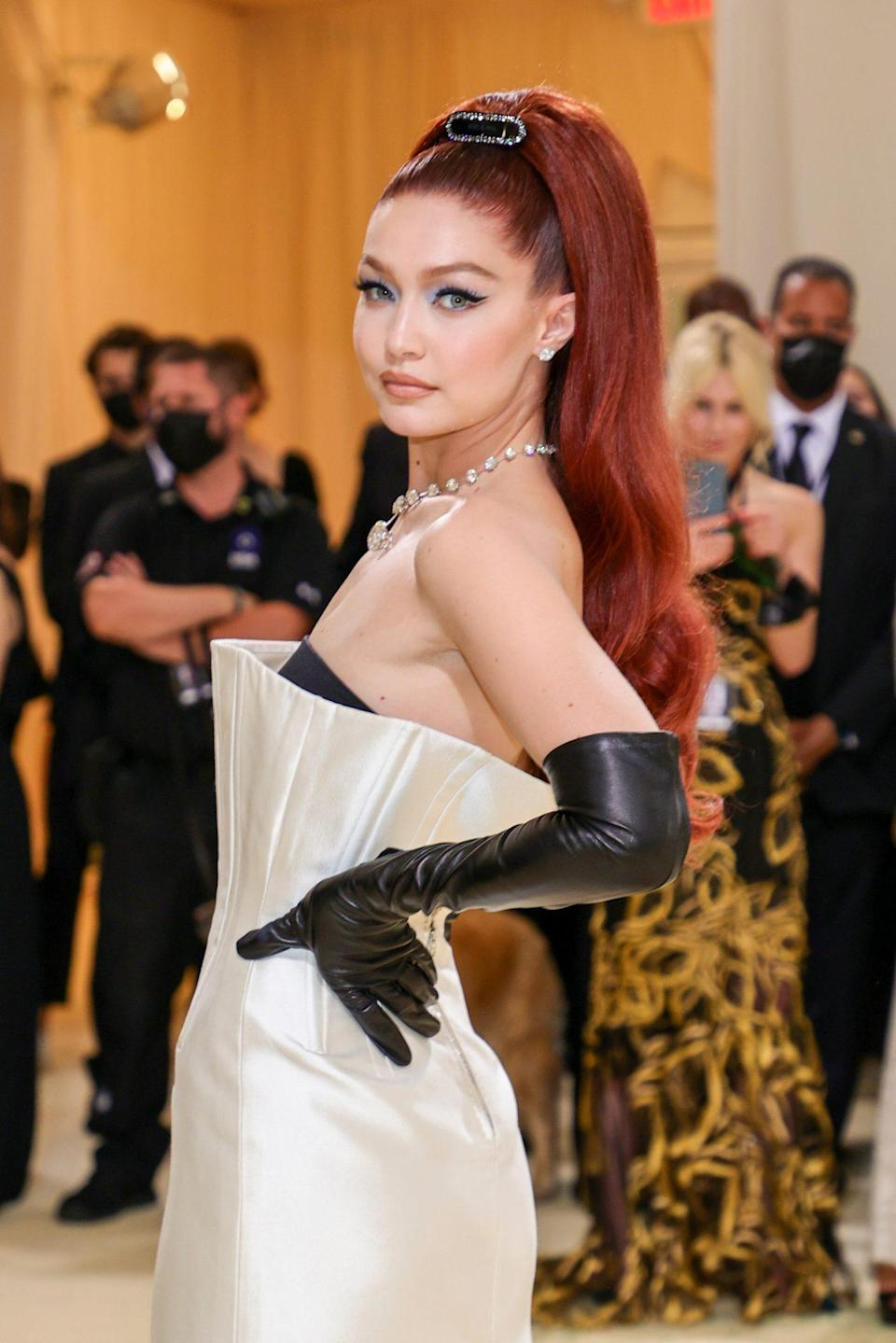<p>As per usual, Gigi Hadid did not disappoint when it came to beauty. Much like others who were walking the red carpet at the 2021 Met Gala, Hadid stepped into Old Hollywood glam with an elaborate red ponytail and a sultry cat eye. </p>