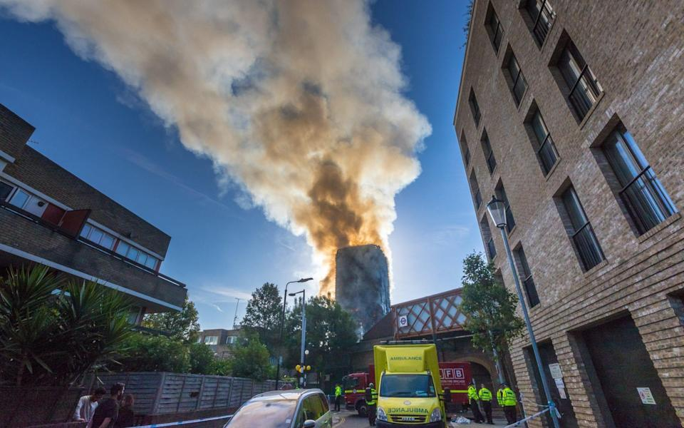 Smoke billows into the summer sky in west London - Credit: Barcroft Media/Paul Davey