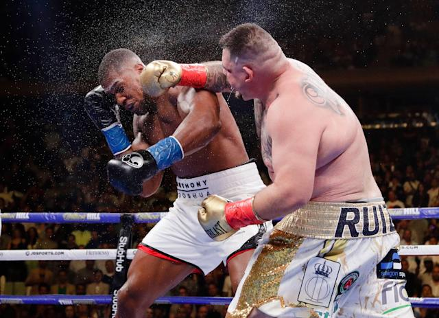 Andy Ruiz, right, punches Anthony Joshua during the seventh round of their heavyweight championship boxing match Saturday in New York. (AP Photo/Frank Franklin II)