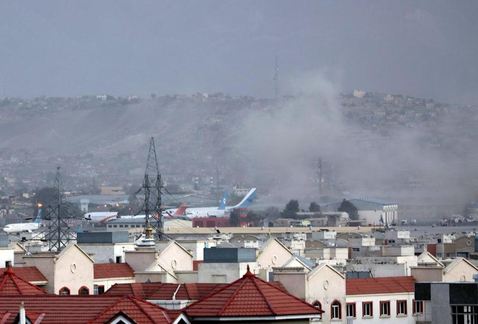 Smoke rises from explosion outside the airport in Kabul (Wali Sabawoon/AP) (AP)