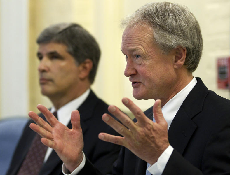 Rhode Island Gov. Lincoln Chafee, right, faces reporters following a closed-door session of the state's Economic Development Corp. board Wednesday, May 16, 2012, in Providence, R.I., as EDC legal counsel David Gilden looks on at left. Former Red Sox pitcher Curt Schilling is asking Rhode Island for additional help to save his video game company, prompting state leaders to consider whether the firm is viable enough to justify the investment. (AP Photo/Steven Senne)