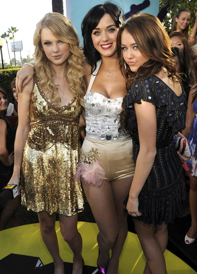 <p>On behalf of MTV, Taylor interviewed both Miley and Katy. All three were nominated for best new artist.</p>