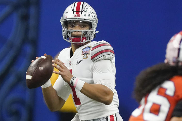 FILE - In this Jan. 1, 2021, file photo, Ohio State quarterback Justin Fields looks for a receiver during the second half of the Sugar Bowl NCAA college football game against Clemson in New Orleans. With Jacksonville set to pick Trevor Lawrence with the No. 1 pick and Zach Wilson appearing to be the favorite to go second to the New York Jets, the San Francisco 49ers will have their choice of Fields, North Dakota State's Trey Lance and Alabama's Mac Jones to be the eventual successor to Jimmy Garoppolo. (AP Photo/John Bazemore, File)