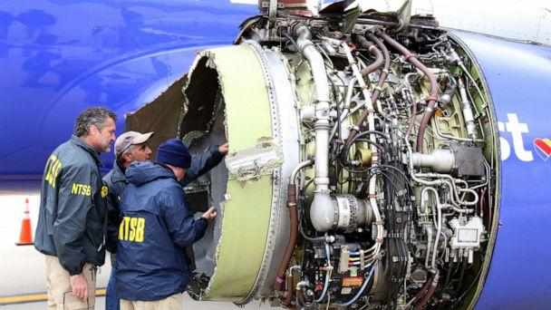 PHOTO: NTSB investigators examine damage to the CFM International 56-7B turbofan engine belonging Southwest Airlines Flight 1380 that separated during flight Philadelphia International Airport in Philadelphia, April 17, 2018. (Handout/Getty Images, FILE)