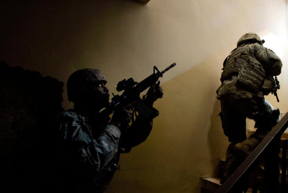 <p>U.S. Army 1st Cavalry Division soldiers of the Charlie Co. 2-12 Cav climb stairs in a building as they look for a sniper that had shot at them minutes before February 8, 2007 in the violent Gazaliyah neighborhood of Baghdad, Iraq. Snipers are a daily problem for US and Iraqi Army soldiers who patrol the neighborhood, which is beset with Sunni-Shia sectarian violence. (Photo by Chris Hondros/Getty Images) </p>