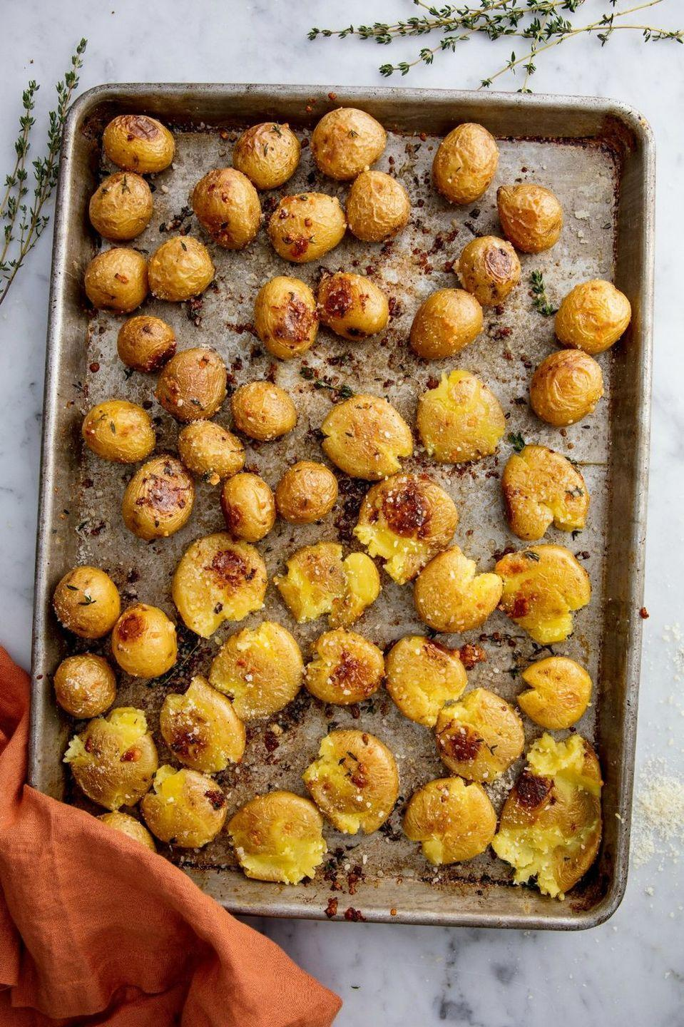 """<p>This recipe is all about the technique, but the flavour profile is infinitely adaptable. Try bacon and cheddar or BRIE.</p><p>Get the <a href=""""https://www.delish.com/uk/cooking/recipes/a28785932/garlic-smashed-potatoes-recipe/"""" rel=""""nofollow noopener"""" target=""""_blank"""" data-ylk=""""slk:Garlic Smashed Potatoes"""" class=""""link rapid-noclick-resp"""">Garlic Smashed Potatoes</a> recipe.</p>"""