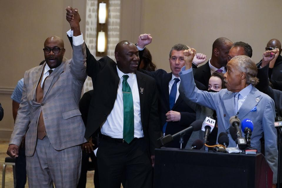 """FILE - In this April 20, 2021, file photo, Philonise Floyd, Attorney Ben Crump and the Rev, Al Sharpton, from left, react after a guilty verdict was announced at the trial of former Minneapolis police Officer Derek Chauvin for the 2020 death of George Floyd, Tuesday,, in Minneapolis, Minn. Former Minneapolis police Officer Derek Chauvin faces decades in prison when he is sentenced Friday, June 25, 2021, following his murder and manslaughter convictions in the death of George Floyd. Floyd's death, filmed by a teenage bystander as Chauvin pinned Floyd to the pavement for about 9 and a half minutes and ignored Floyd's """"I can't breathe"""" cries until he eventually grew still, reignited a movement against racial injustice that swiftly spread around the world and continues to reverberate. (AP Photo/Julio Cortez, File)"""
