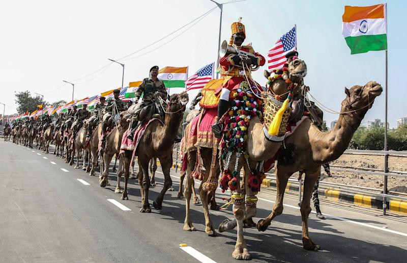 Mounted soldiers ride camels outside the Sardar Patel Gujarat Stadium in Ahmedabad, where Trump and Modi will hold a rally on Monday: EPA