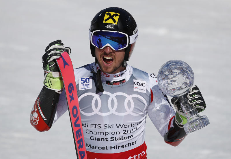 World Cup men's giant slalom overall champion Austria's Marcel Hirscher holds up the crystal globe trophy after a men's World Cup giant slalom ski race Saturday, March 18, 2017, in Aspen, Colo. (AP Photo/Brennan Linsley)