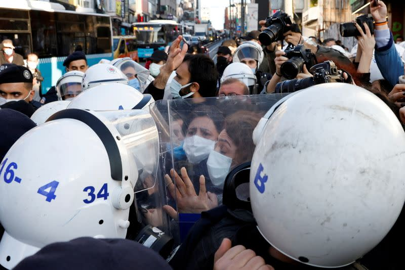 People attend a demonstration in Istanbul