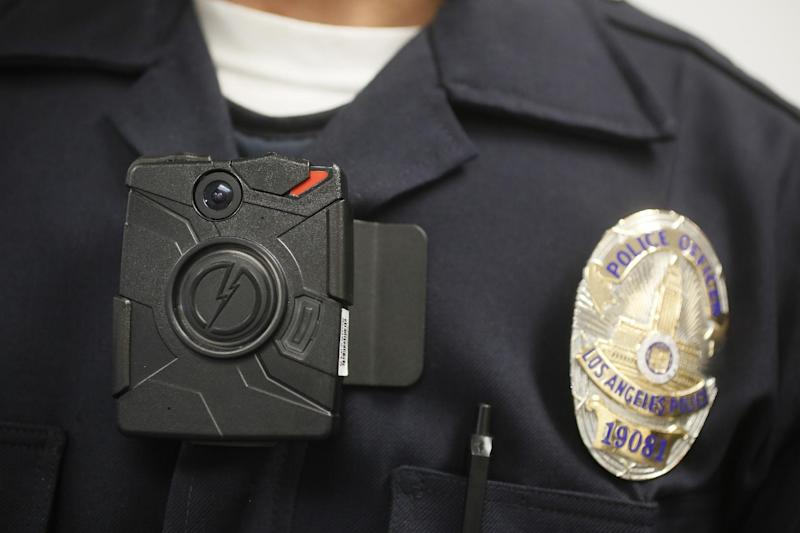 This Jan. 15, 2014 file photo shows a Los Angeles Police officer wearing an on-body cameras during a demonstration for media in Los Angeles. Thousands of police agencies have equipped officers with cameras to wear with their uniforms, but they've frequently lagged in setting policies on how they're used, potentially putting privacy at risk and increasing their liability. As officers in one of every six departments across the nation now patrols with tiny lenses on their chests, lapels or sunglasses, administrators and civil liberties experts are trying to envision and address troublesome scenarios that could unfold in front of a live camera. (AP Photo/Damian Dovarganes)