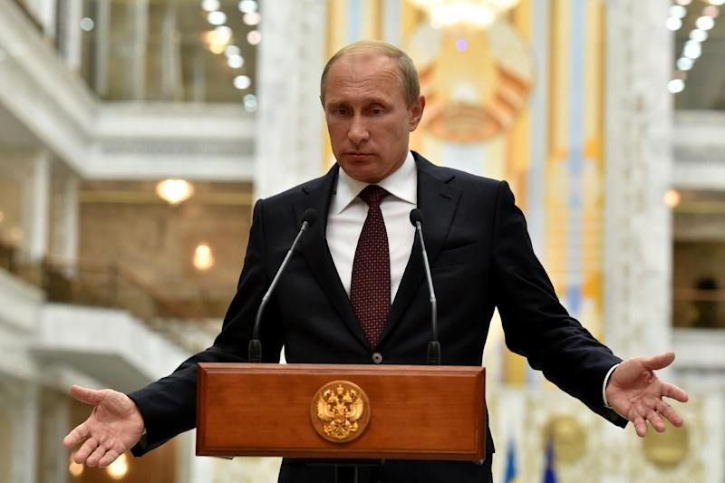 Russia's President Vladimir Putin gives a press conference in Minsk on August 27, 2014