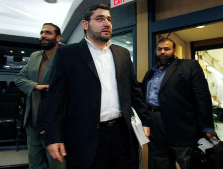 FILE PHOTO --  Muayyed Nureddin (L) arrives for the start of a news conference with Abdullah Almalki (C) and Ahmad El Maati in Ottawa October 21, 2008.   REUTERS/Chris Wattie/File Photo