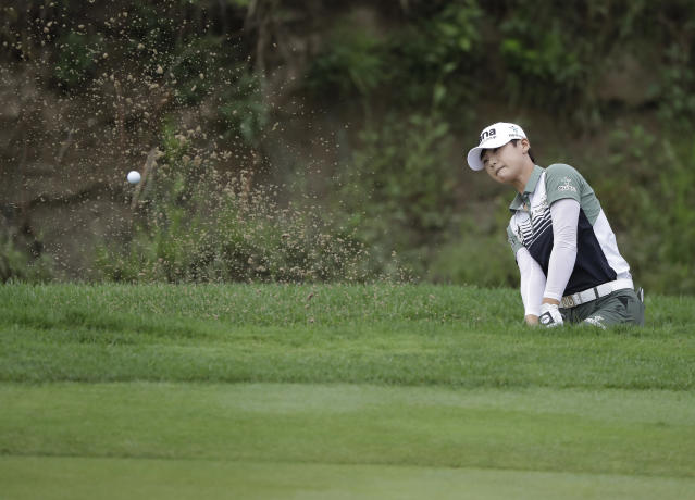 Sung Hyun Park, of South Korea, hits hits out of the bunker on the seventh hole during the second round of the Indy Women in Tech Championship golf tournament, Friday, Aug. 17, 2018, Indianapolis. (AP Photo/Darron Cummings)