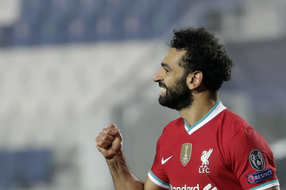 FILE - Liverpool's Mohamed Salah celebrates his goal against Atalanta during the Champions League, group D soccer match between Atalanta and Liverpool, at the Gewiss Stadium in Bergamo, Italy, Tuesday, Nov. 3, 2020. Salah has tested positive for the coronavirus. The announcement was made by the Egyptian soccer association on Twitter, Friday, Nov. 13, ahead of Saturday's game against Togo. (AP Photo/Luca Bruno)