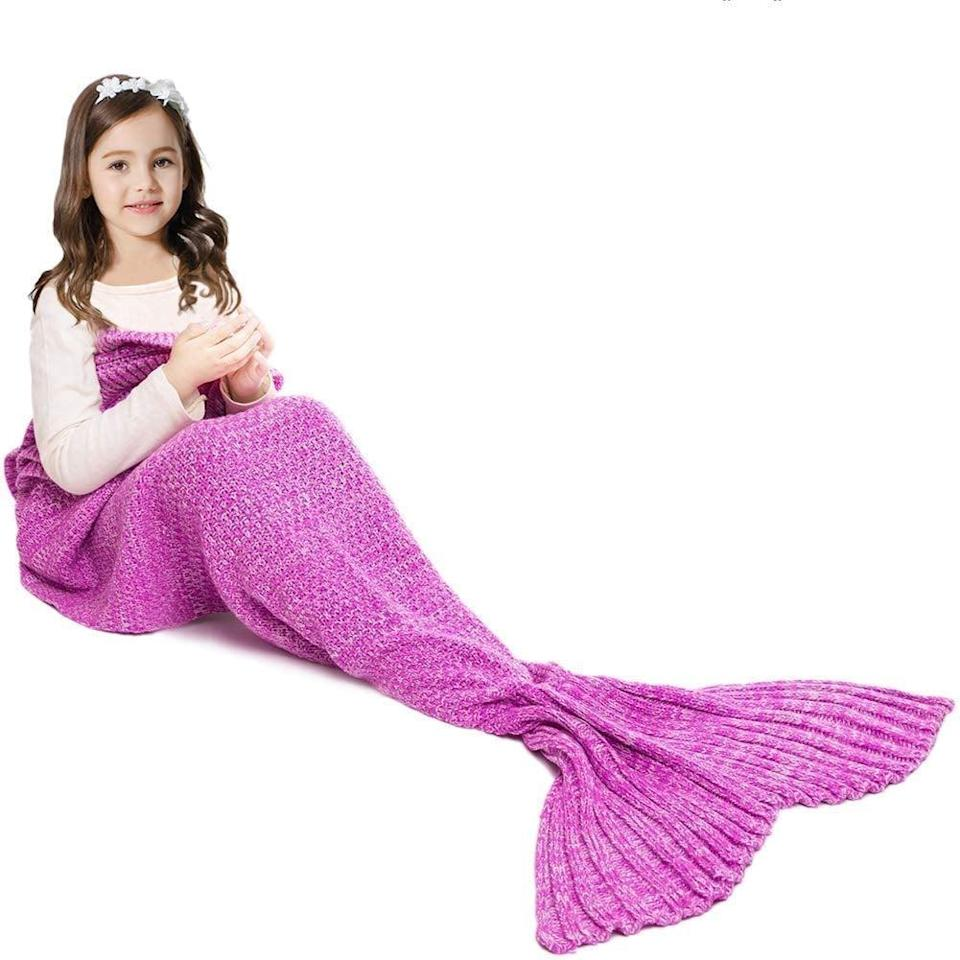 """<p>If you know a kid who loves mermaids, no doubt they'll be totally into this cozy <a href=""""https://www.popsugar.com/buy/Mermaid-Tail-Blanket-Kids-495057?p_name=Mermaid%20Tail%20Blanket%20for%20Kids&retailer=amazon.com&pid=495057&price=19&evar1=moms%3Aus&evar9=25997679&evar98=https%3A%2F%2Fwww.popsugar.com%2Fphoto-gallery%2F25997679%2Fimage%2F46685450%2FMermaid-Tail-Blanket-for-Kids&list1=holiday%2Cgift%20guide%2Ckid%20shopping%2Choliday%20living%2Choliday%20for%20kids&prop13=api&pdata=1"""" class=""""link rapid-noclick-resp"""" rel=""""nofollow noopener"""" target=""""_blank"""" data-ylk=""""slk:Mermaid Tail Blanket for Kids"""">Mermaid Tail Blanket for Kids</a> ($19).</p>"""