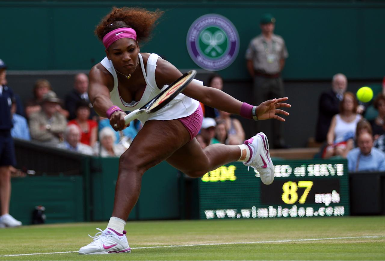 LONDON, ENGLAND - JUNE 30:  Serena Williams of the USA  returns a shot during her Ladies' Singles third round match against Jie Zheng of China on day six of the Wimbledon Lawn Tennis Championships at the All England Lawn Tennis and Croquet Club at Wimbledon on June 30, 2012 in London, England.  (Photo by Clive Brunskill/Getty Images)